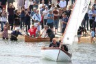 """Foreground – Dominic Frankis in his 12'5"""" Mallard Dinghy, with James Downs in the background celebrating with champagne in his 14' 3"""" Canadian Canoe"""