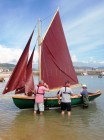 """Martin McMahon's 16'5"""" Islay Skiff with student Jim Walsh and BBA Graduate and woman gig-builder Gail McGarva in waders"""